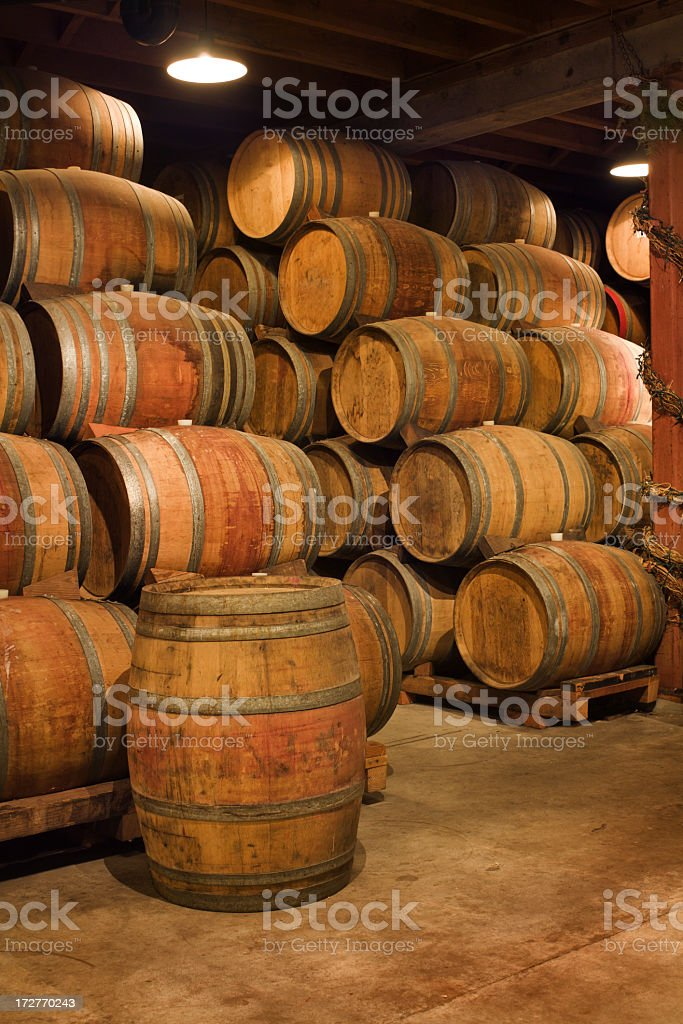Old Wine Barrels Stacked in Winery Aging Cellar, Napa Valley royalty-free stock photo