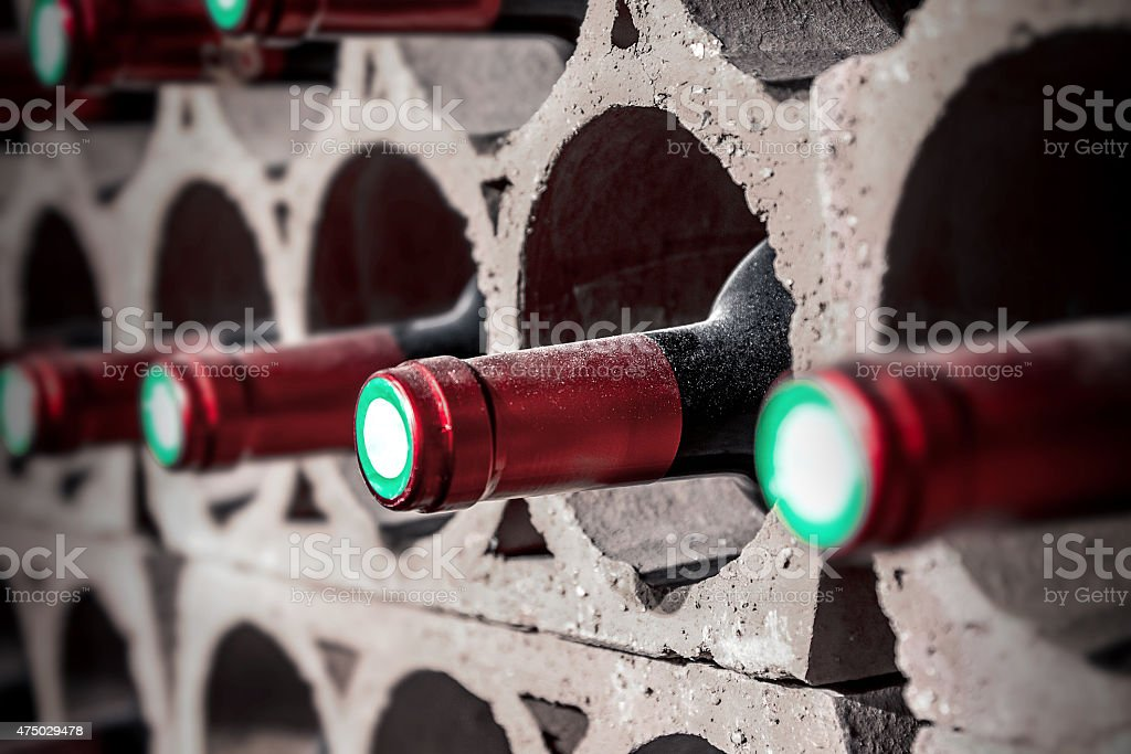 Old wine bottles from cellar in selective focus stock photo