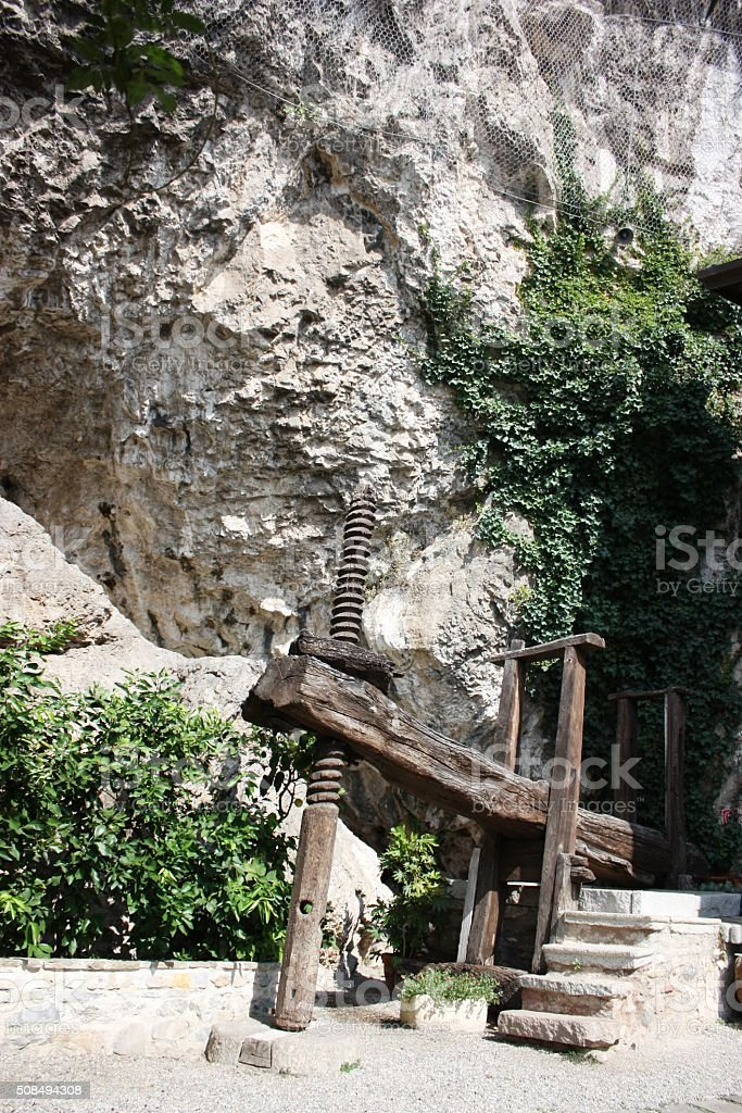 old wine press in courtyard Santa Caterina del Sasso, Italy stock photo
