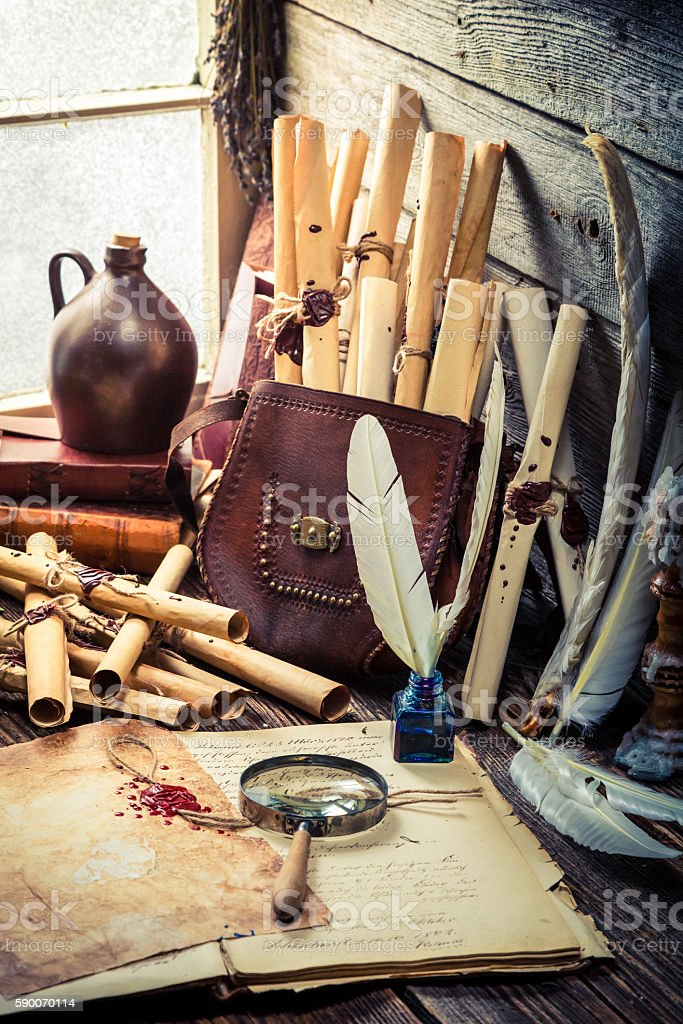 Old witch workshop full of scrolls and recipe stock photo