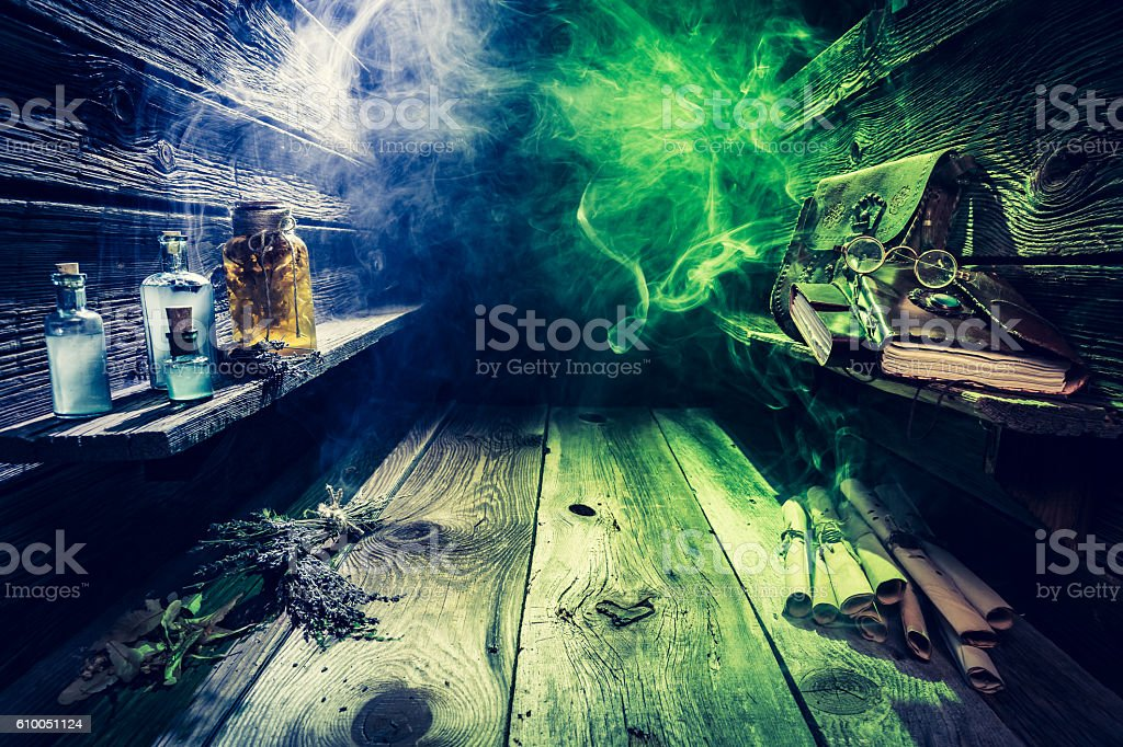 Old witcher cottage full of scrolls, books, magic potions stock photo