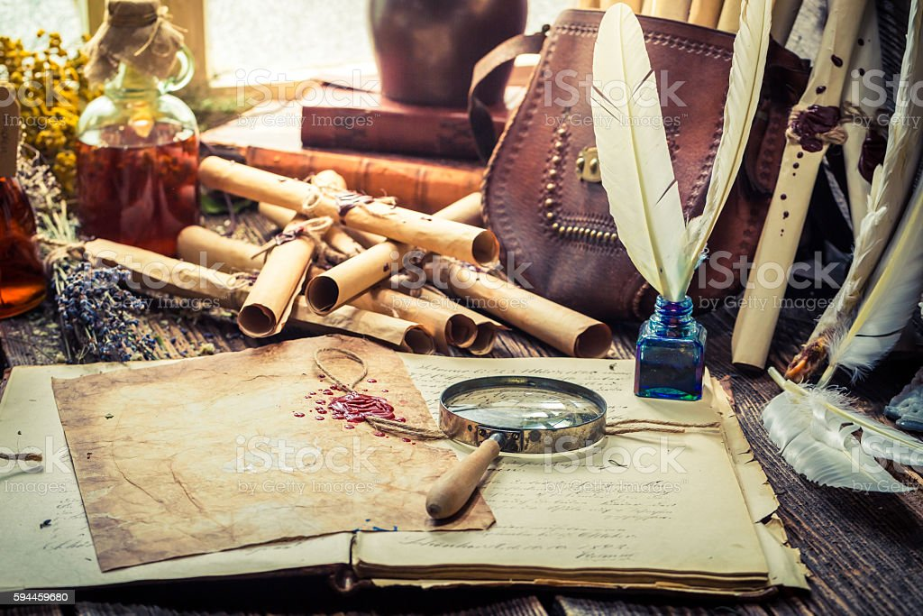 Old witcher labolatory full of scrolls and recipe stock photo