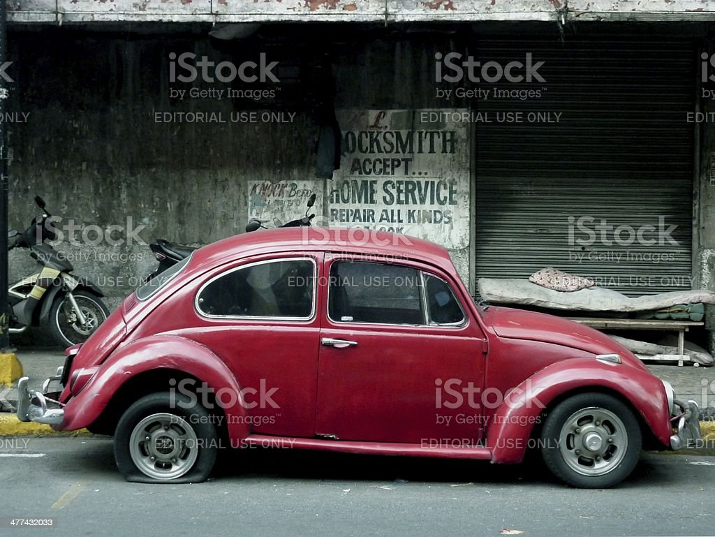 Old Wolkswagen Beetle with flat tire,  Manila Philippines stock photo