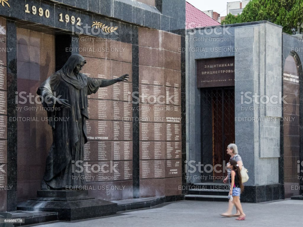 Tiraspol, Transnistria (Moldova) - August 12, 2016: Old woman and her granddaughter mourning in front of a monument erected to commemorate the 1992 Transnitria civil war'n stock photo
