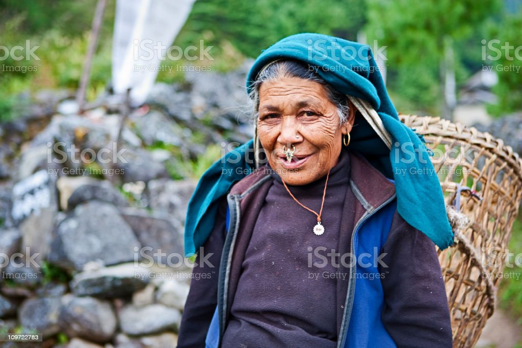 Old woman carrying basket stock photo
