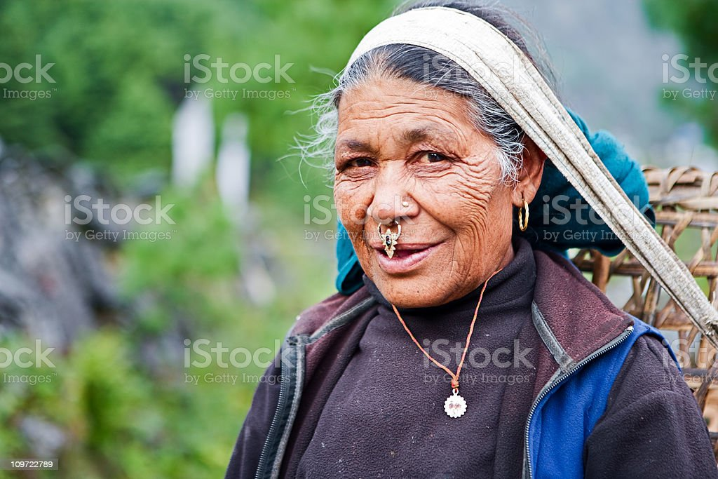 Old woman carrying basket royalty-free stock photo