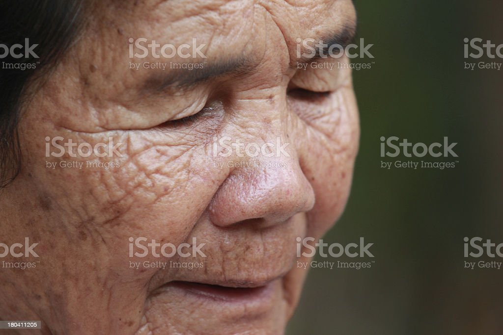old woman closes one's eyes royalty-free stock photo