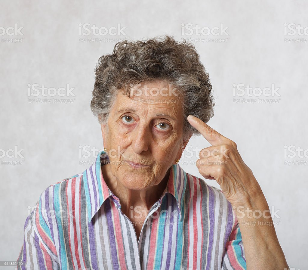 Old woman between 70 and 80 years old wants to draw someones attention
