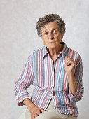Old woman draws tries to draw attention of others