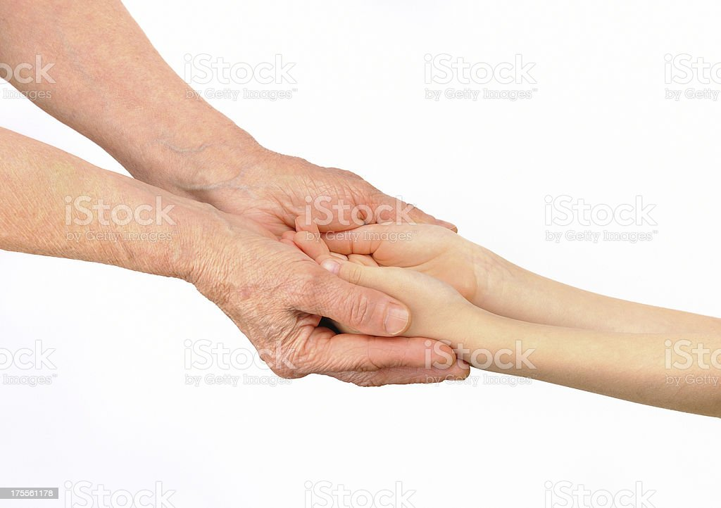 Old woman embracing hands of grandchild royalty-free stock photo