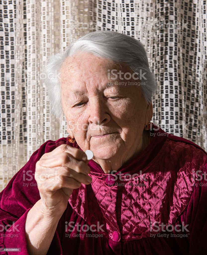 Old woman going to take the medicine stock photo