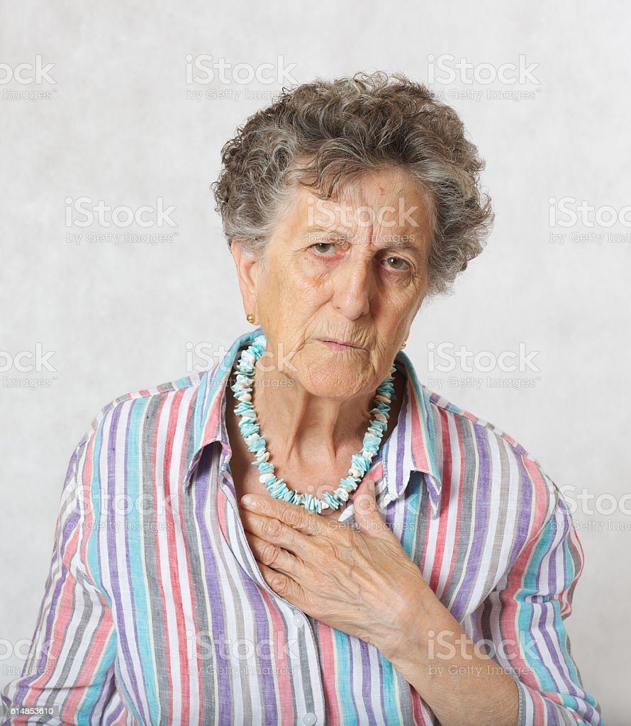 Old woman has a feeling of suffocation stock photo