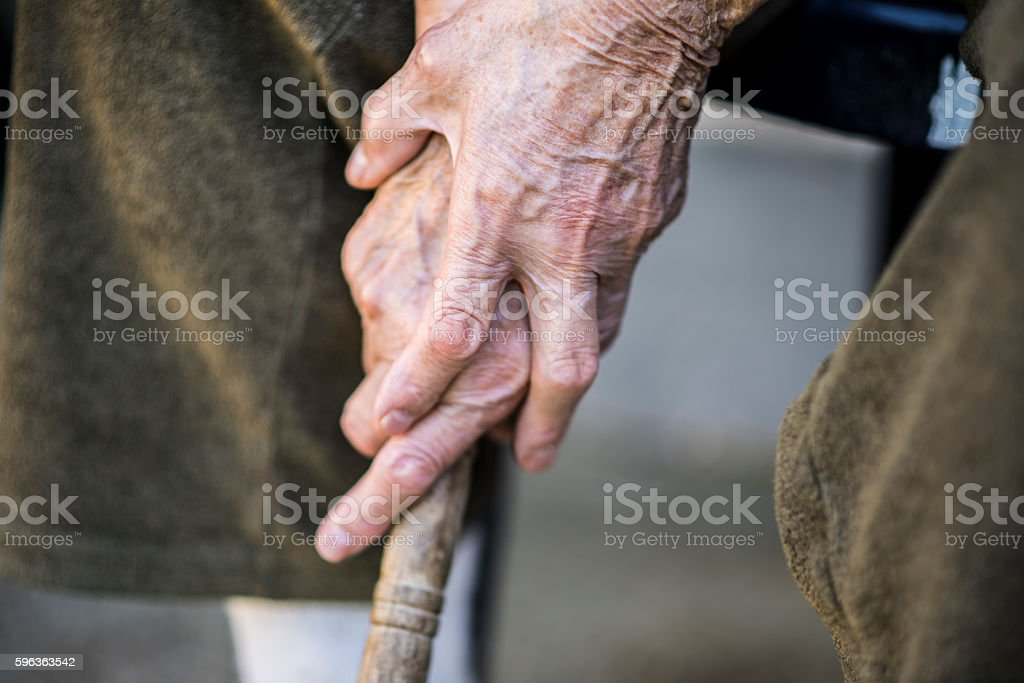 Old woman holding a walking cane stock photo