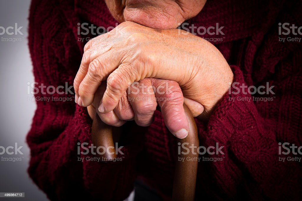 Old woman holding walking stick royalty-free stock photo