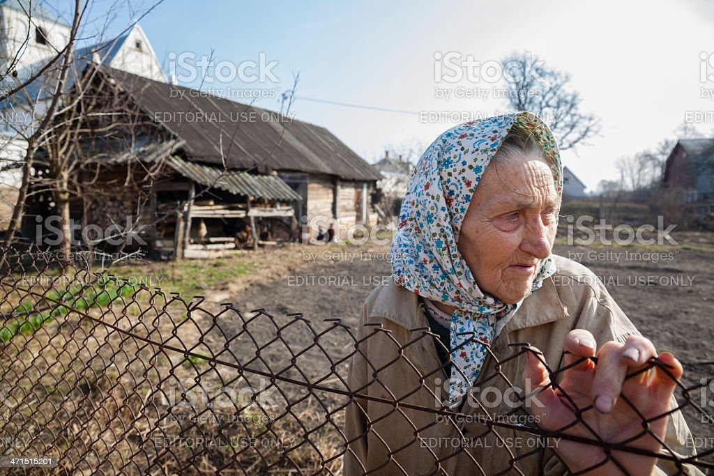 Old woman in her vegetable garden royalty-free stock photo