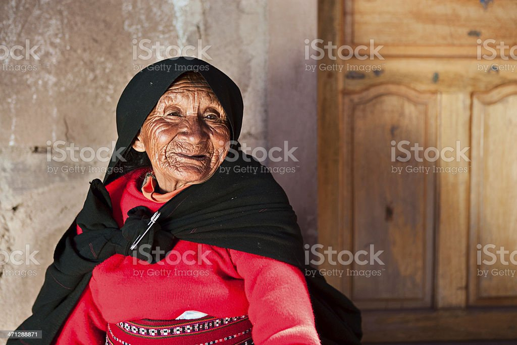 Old woman in national dress on Taquile Island, Peru royalty-free stock photo