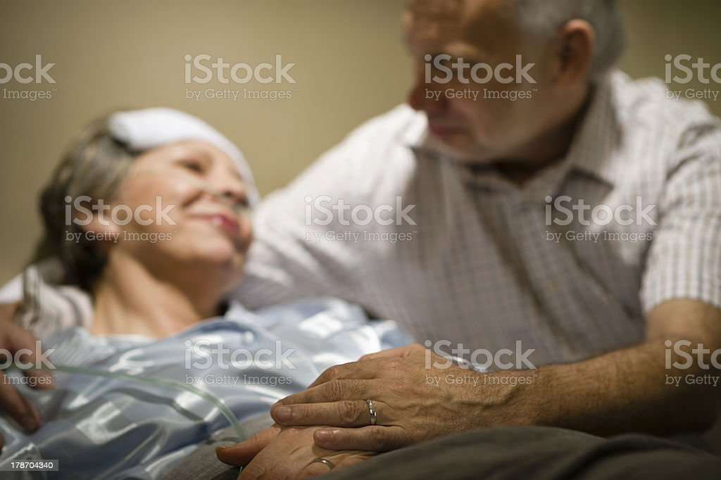 Old woman in pain lying bed stock photo