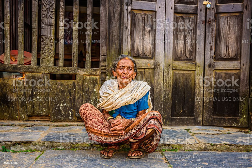 Old woman in the street of Bandipur, Nepal stock photo