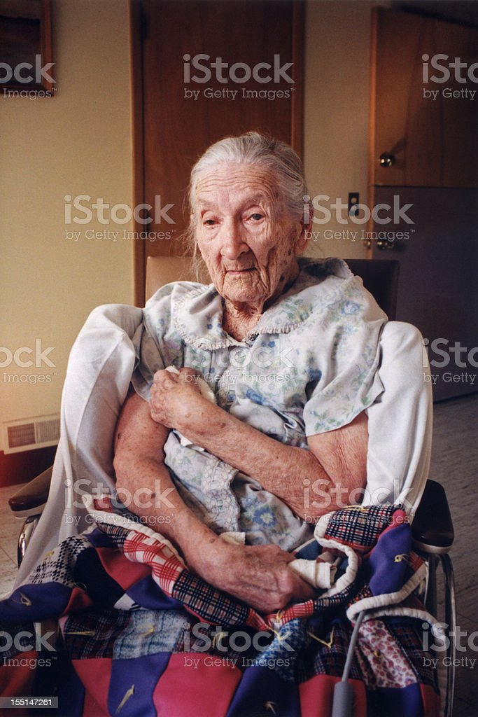 old woman in wheel chair in nursing home stock photo