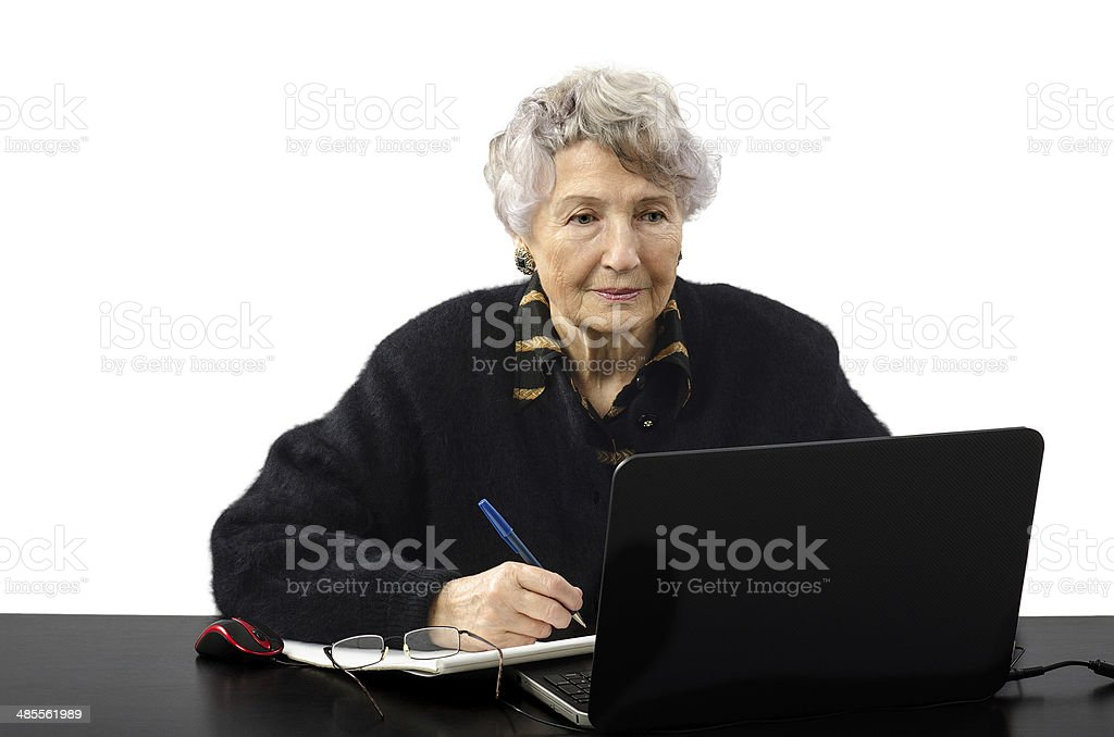 Old woman is elearning student stock photo