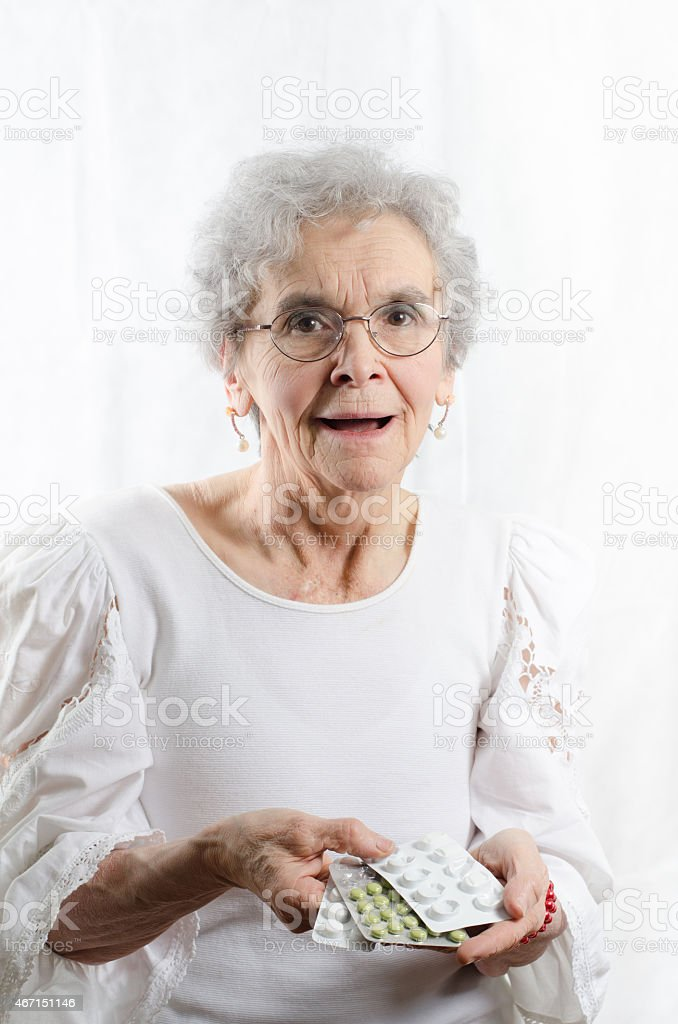 old woman is giving back pills stock photo