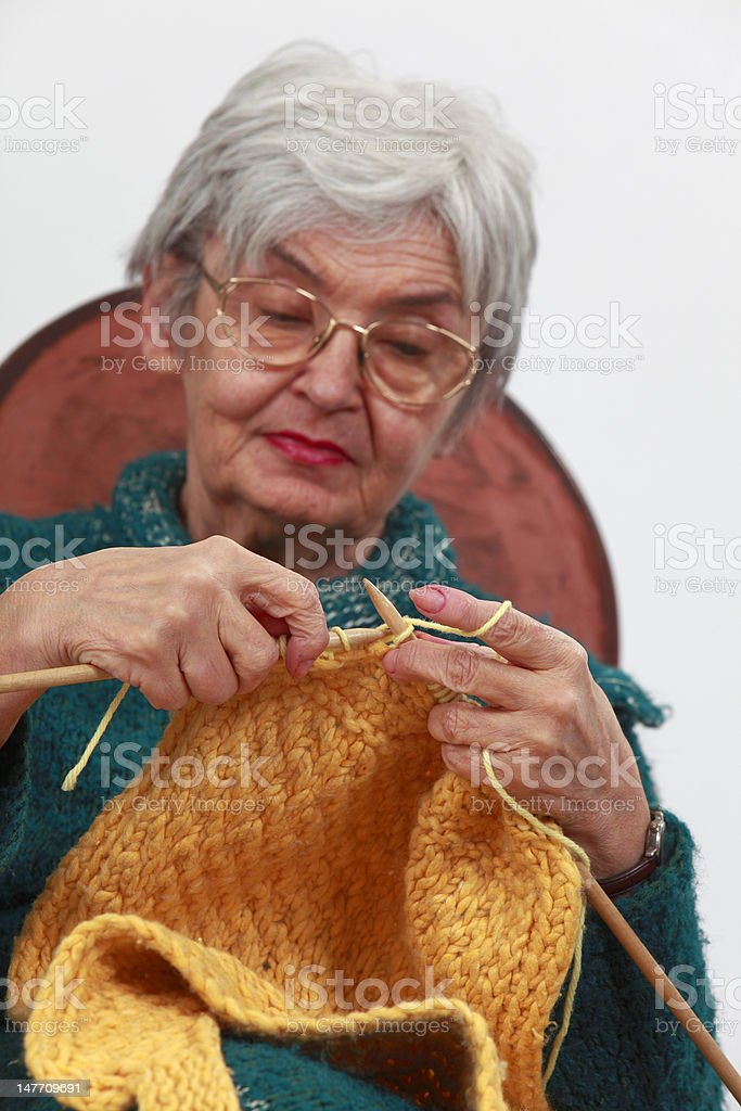 Old woman knitting royalty-free stock photo