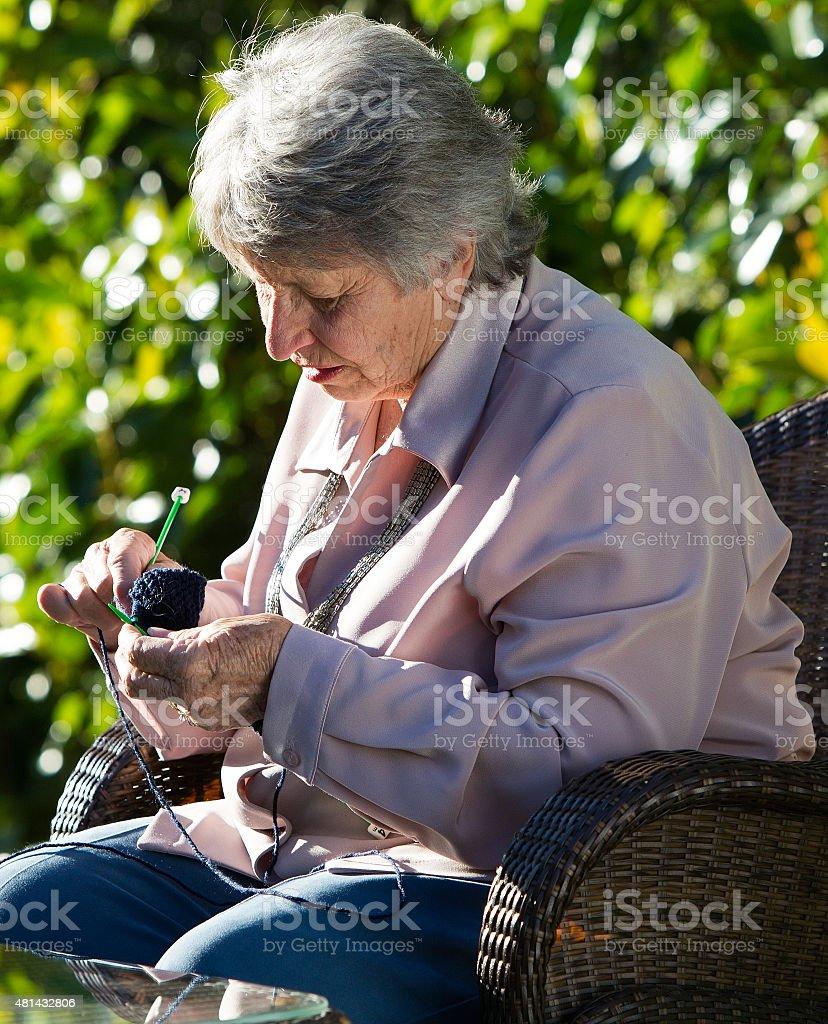 Old Woman knitting royalty-free stock photo