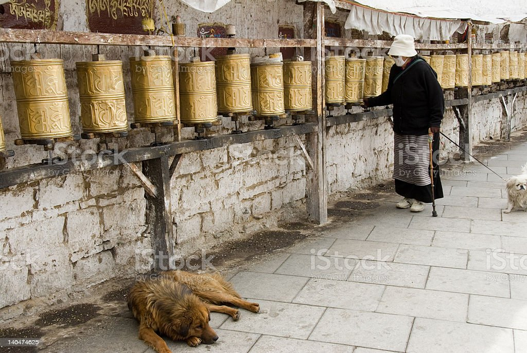 Old woman prayer wheels 1 royalty-free stock photo