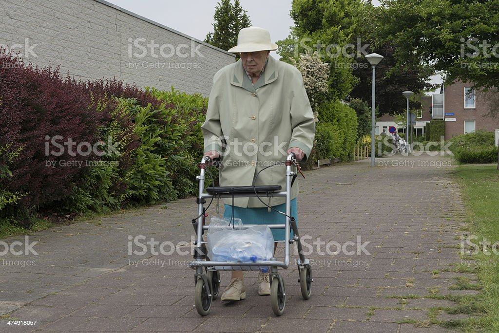 old woman recycles plastic stock photo