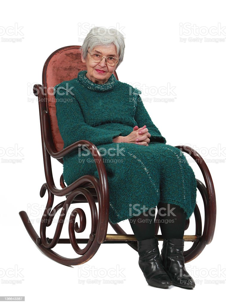 Old woman sitting on antique rocking chair stock photo