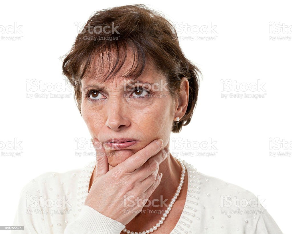 Old woman thinking and looking up at the left corner royalty-free stock photo