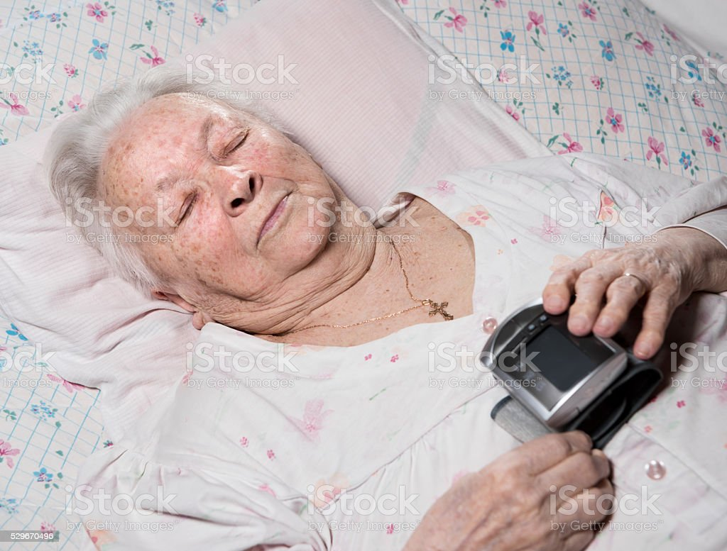 Old woman with arterial pressure measure stock photo