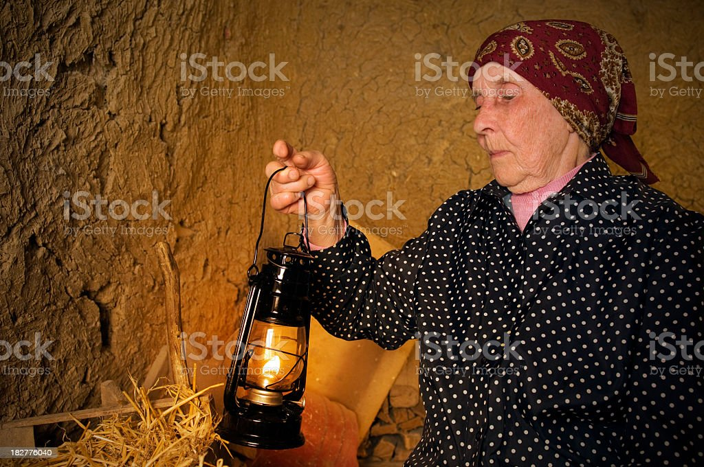 Old woman with lamp royalty-free stock photo