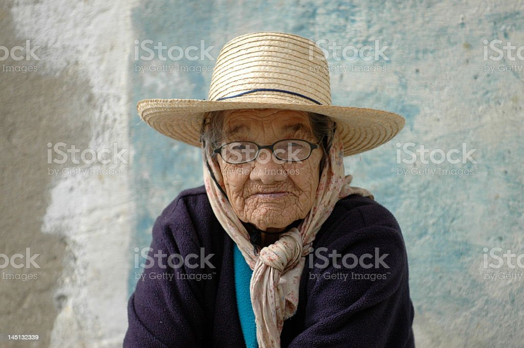 Old woman with sun hat and glasses stock photo