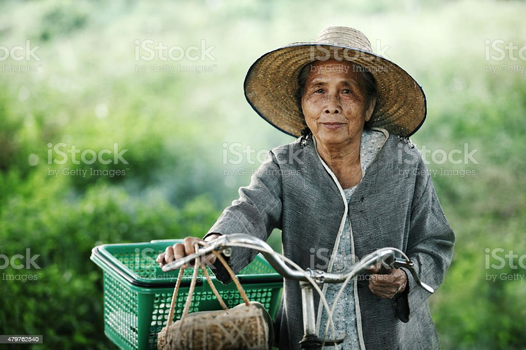 Old women couple with their bikes outdoors stock photo