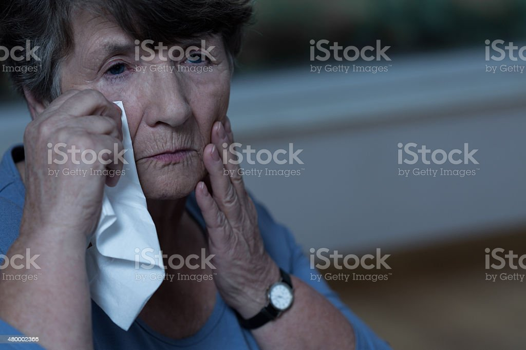 Old women crying stock photo