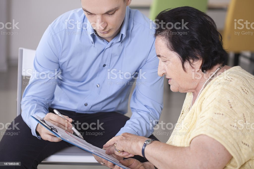Old women with consultant. royalty-free stock photo