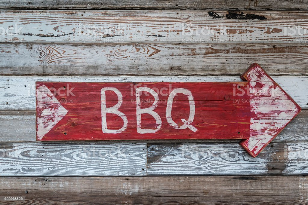Old Wood Arrow BBQ Sign stock photo