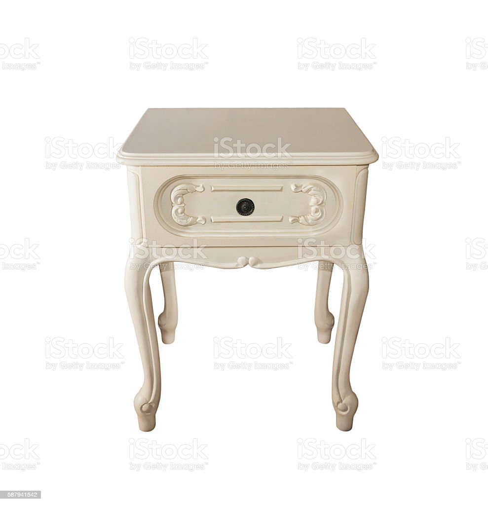 Old wood bedside table carved  on an isolated background stock photo