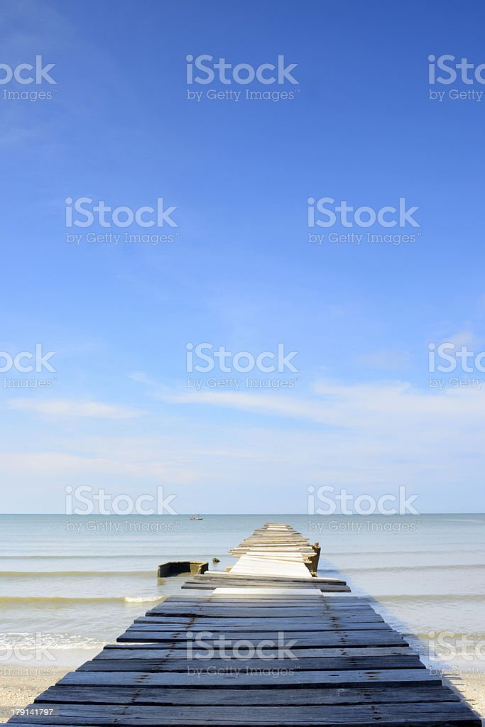 Old wood bridge on the beach royalty-free stock photo