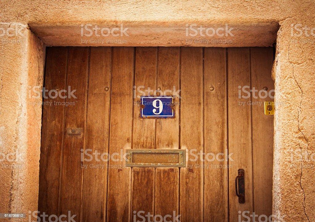 Old wood door in Bonifacio, Corsica stock photo