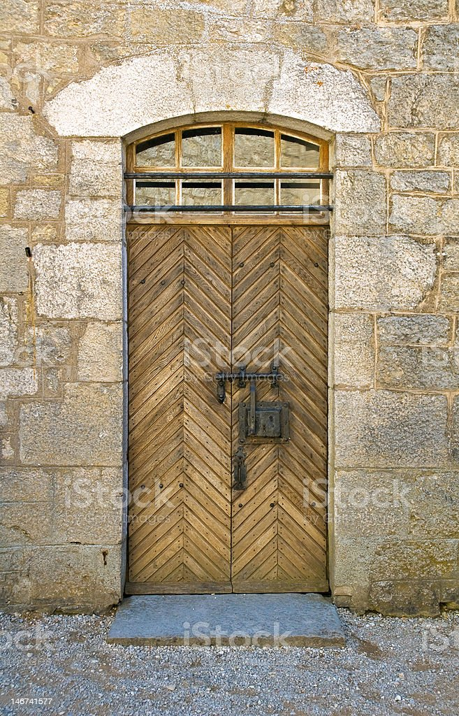 Old wood door in castle of Joux stock photo