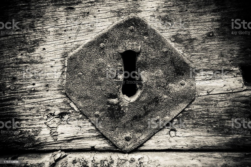 Old Wood Door Keyhole Detail, Black and White royalty-free stock photo