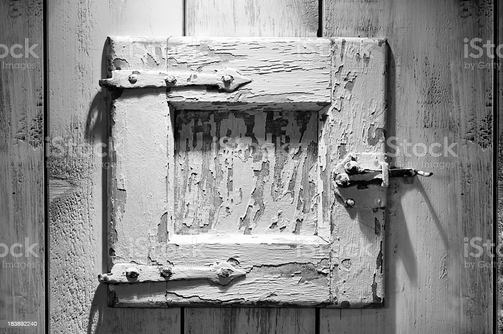 Old Wood Door Textured and Weathered in BW royalty-free stock photo