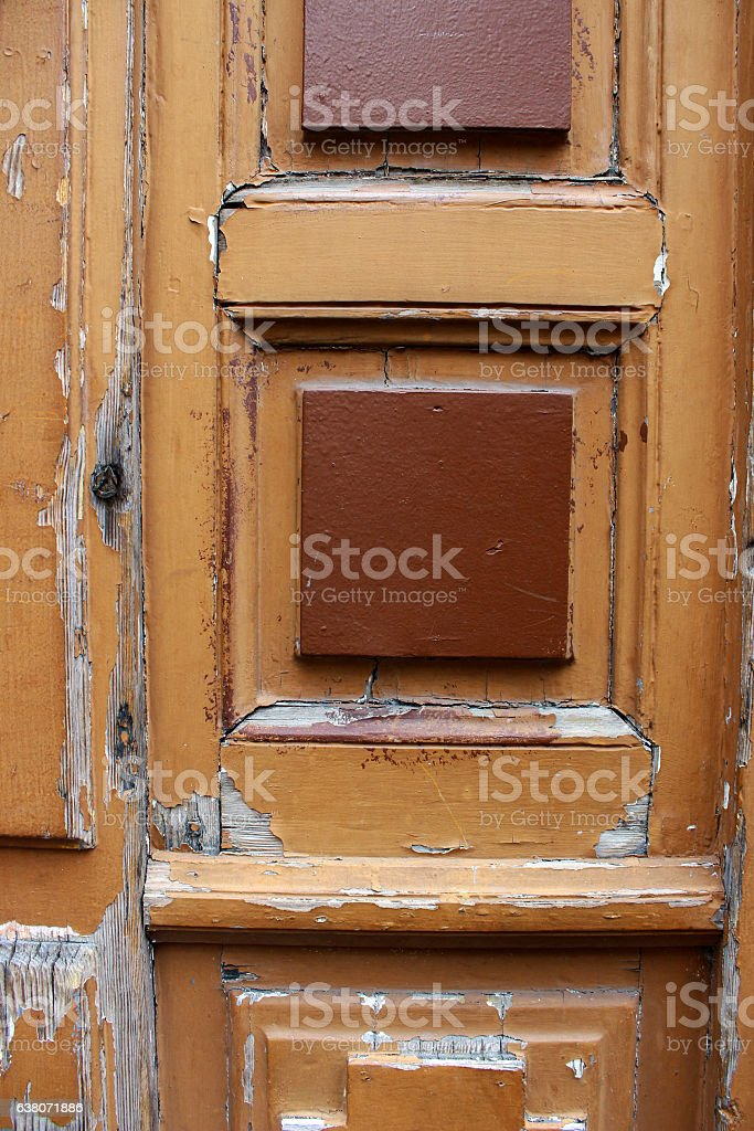 Old wood door with flaking paint stock photo