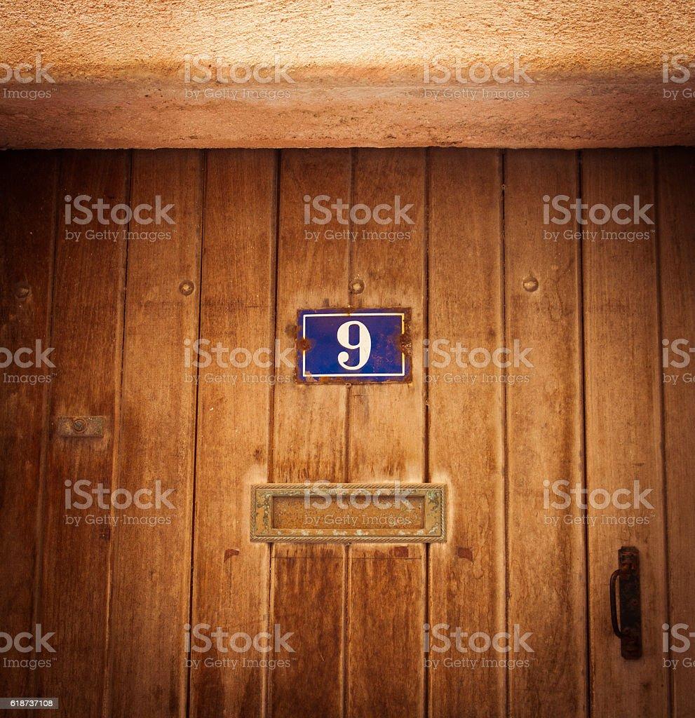 Old wood house doorin Bonifacio Corsica stock photo