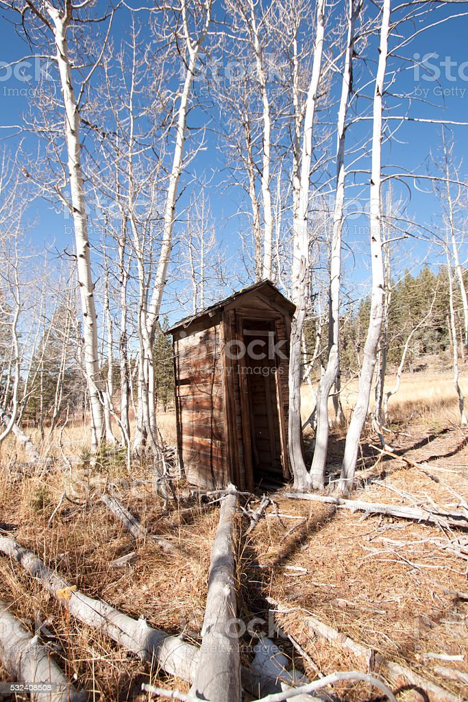 Old wood outhouse stock photo