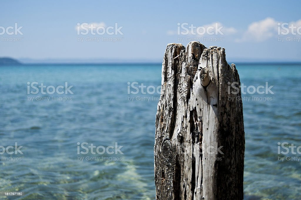 Old wood post with sea background royalty-free stock photo