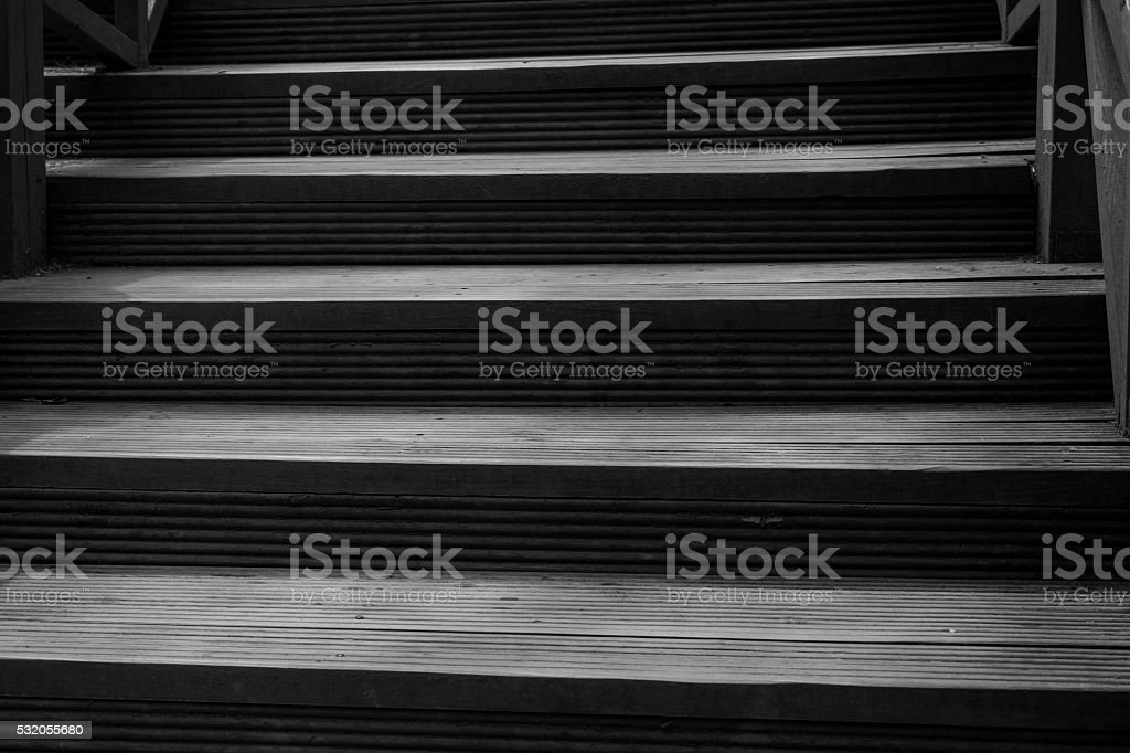 Old wood steps leading up a dark alleyway stock photo