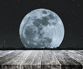 Old wood table top with beautiful full moon at night